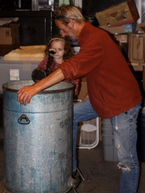 Scott and Maeve extruding the honey.
