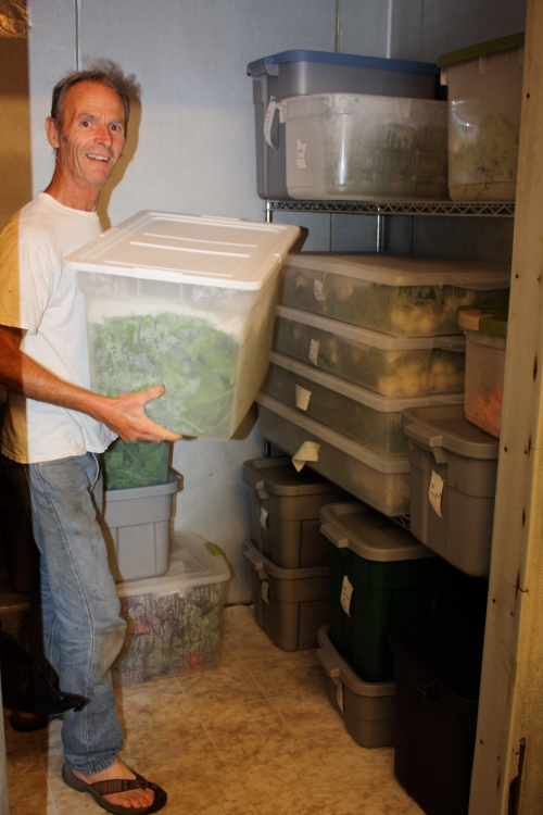 Scott with all the produce in the cooler washed weighed and ready to be portioned out.