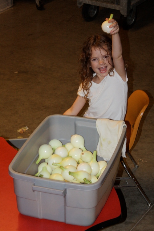 Maeve cleaning onions.