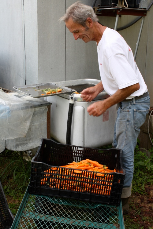 Scott washing the carrots in the old wringer washer.