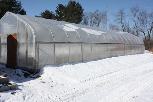 An outside view of the hoop house.