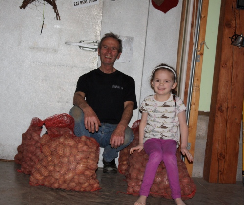Scott and Maeve with 300 pounds of seed potatoes.