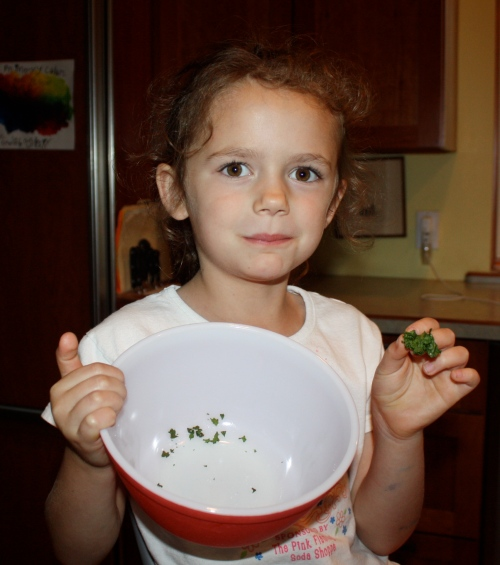 Maeve polishing off another bowl of Kale Crisps.