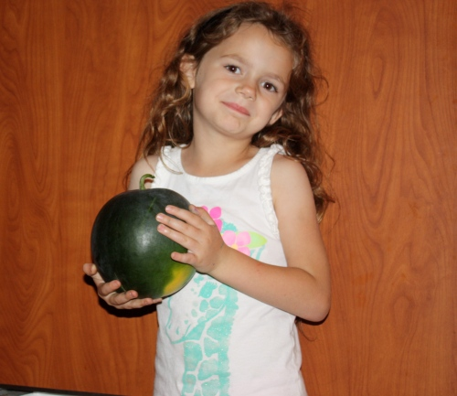 Maeve with the watermelon check.