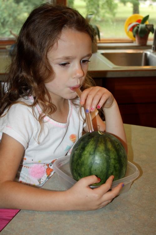 Maeve drinking her watermelon juice.
