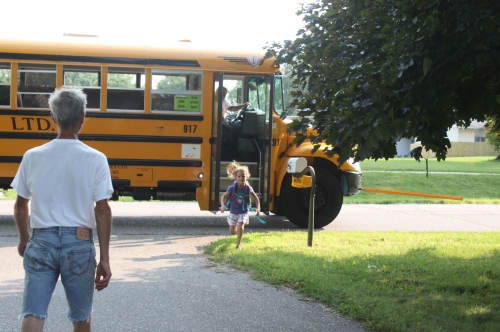 Maeve getting off the bus on the 1st day of school.