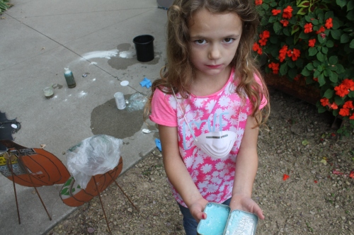 Maeve kept herself busy while we were packaging shares. She decided to make a deer repealent for the garden....dish soap, baking soda, mints and cinnamon. Thnk it will work?