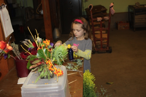 Maeve making a few fresh floral bouquets too for Thanksgiving.